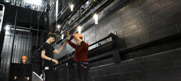 Two students fitting lights in The Sainsbury Theatre