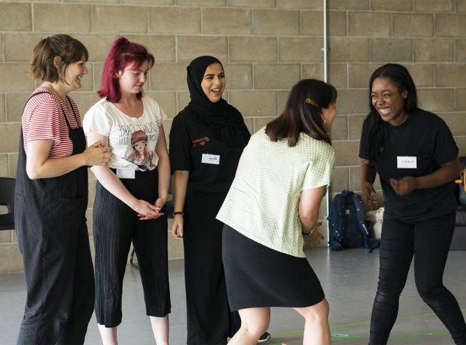 A group of female LAMDA Exam students laughing